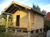 Фото 1. Столбчатый фундамент из асбестового трубопроката для деревянного дома