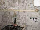 фото - прячем газовый трубопровод на кухне