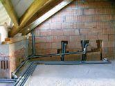 Фото – Пример устройства системы отвода сточных вод мансардного этажа с учетом минимального уклона канализации.
