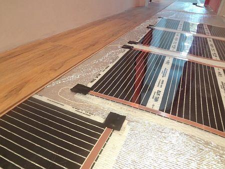 Фото — Инфракрасный плёночный пол под ламинат.