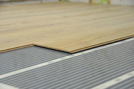 Фото — Ламинат на тёплом инфракрасном полу.