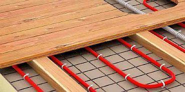 Фото — Деревянное покрытие на водяной тёплый пол