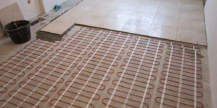 Фото — Тёплый пол под керамическую плитку в частном доме