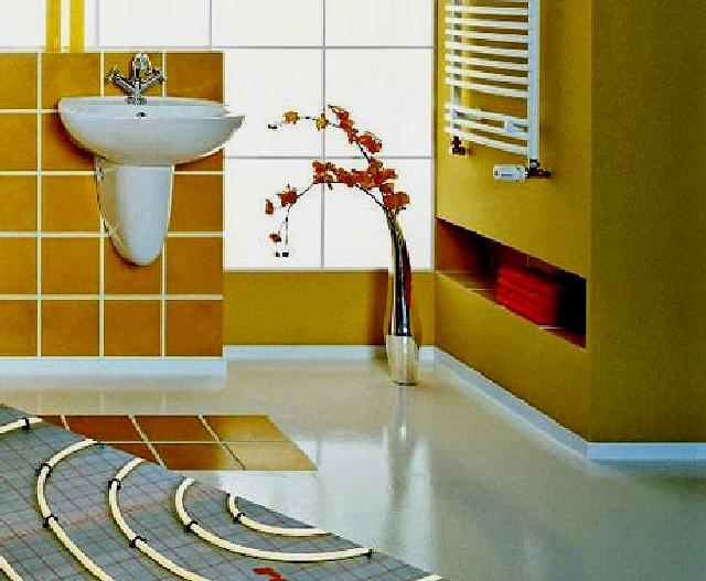 Фото — Тёплые водяные полы от полотенцесушителя