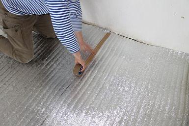 Фото — Укладка подложки под инфракрасный тёплый пол