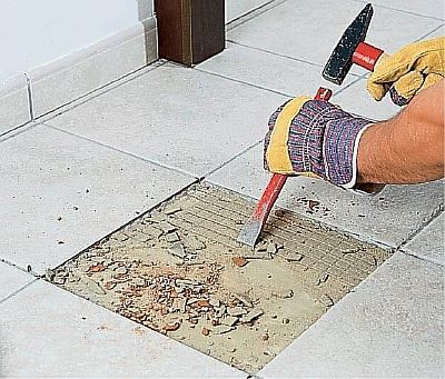Фото — Демонтаж покрытия на водяном полу